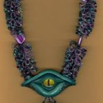 amazing beaded statement necklace with a custom made dragon's eye focal
