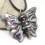 Mauve Butterfly Pendant with Faux Silver Flames on Wings