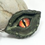golden green dragon's eye pendant